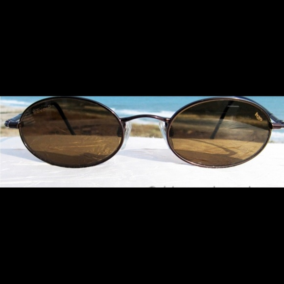 2eeaf425b6 Revo unisex sunglasses. M 5b3ba0ad194dadf90c70d082. Other Accessories ...